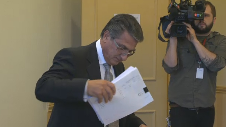 Former city manager Robert Abdallah arrives at a news conference he called to defend his reputation (Oct. 18, 2012)