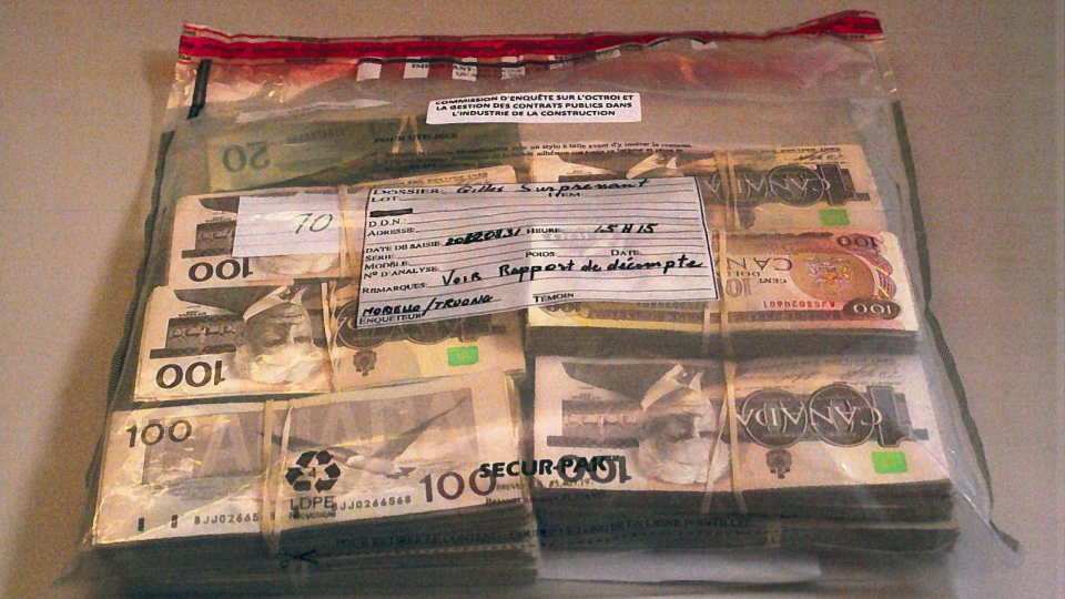 A bag containing $123,000 returned by Gilles Surprenant at the Charbonneau Commission is shown in a handout photo, released on Thursday October 18, 2012. THE CANADIAN PRESS