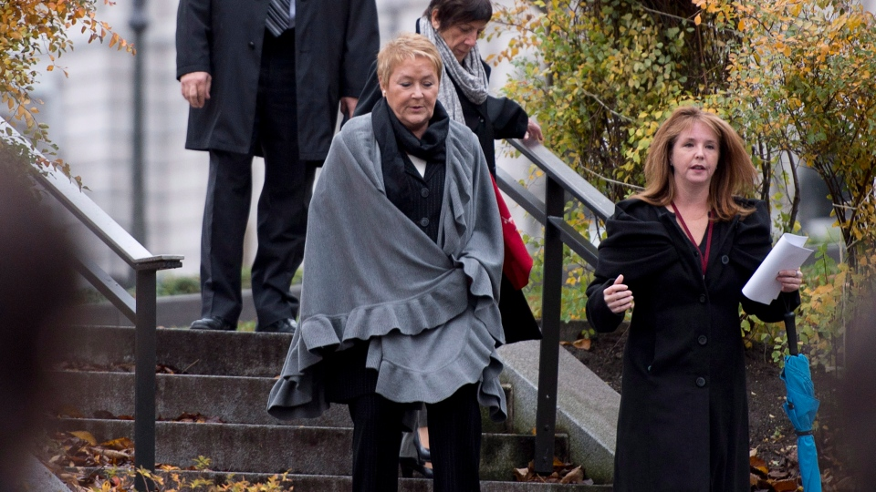 Quebec Premier Pauline Marois, centre, walks to a ceremony at the statue of former premier Rene Levesque, Thursday, November 1, 2012 on the legislature grounds in Quebec City. The ceremony marks the 25th anniversary of his death. Marois's press attache Marie Barrette, right, walks along.THE CANADIAN PRESS/Jacques Boissinot