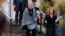 Quebec Premier Pauline Marois, centre, walks to a