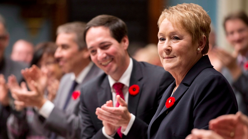 Pauline Marois began wearing the white fleur de lis pin inside the poppy on October 31, 2012 (THE CANADIAN PRESS/Jacques Boissinot)