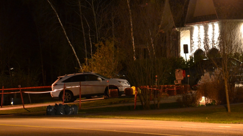 Orange police tape surrounds the driveway in Blainville where mafia second-in-command Joe Di Maulo was assassinated (Nov. 4, 2012. CTV Montreal/Cosmo Santamaria)