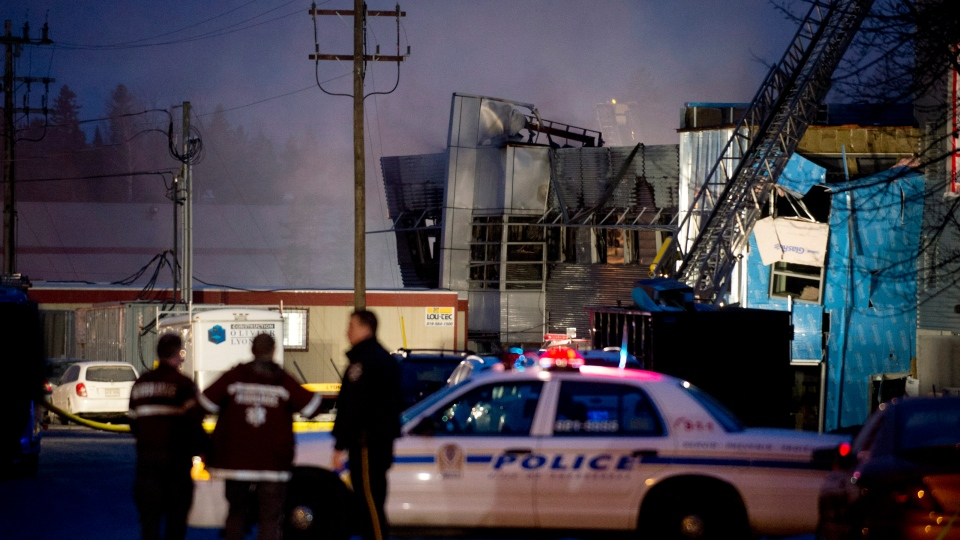Emergency crews are shown outside Neptune Technologies in Sherbrooke, Que., Thursday, Nov. 8, 2012. (Graham Hughes / THE CANADIAN PRESS)