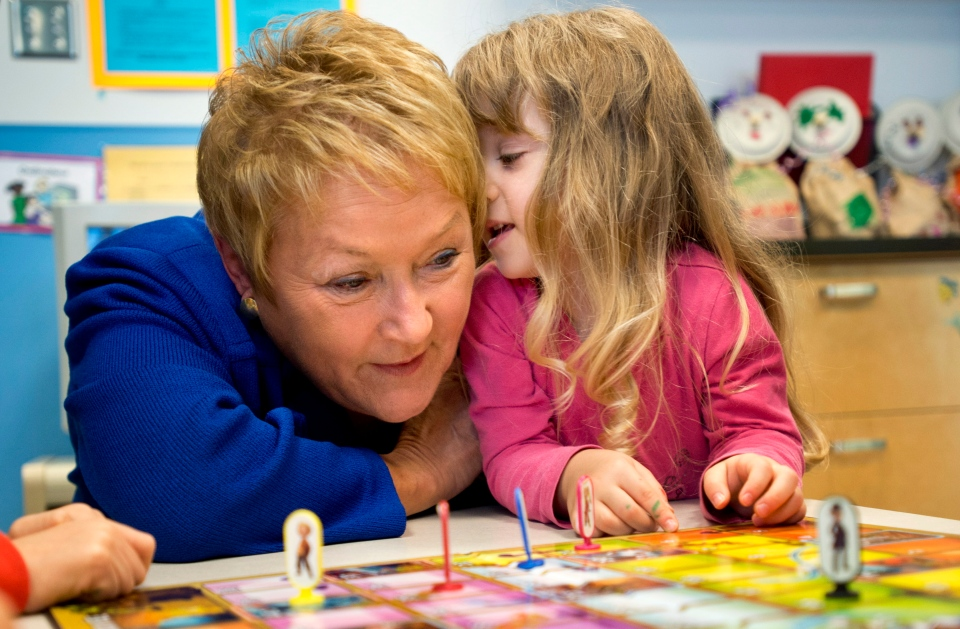 A young girl whispers her name in the ear of Quebec Premier Pauline Marois at a daycare, Monday, November 12, 2012 in Montreal. Marois announced new places in daycare. THE CANADIAN PRESS/Paul Chiasson