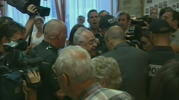 The mayor of Mascouche, Richard Marcotte, was swarmed the last time he attended a city council meeting.