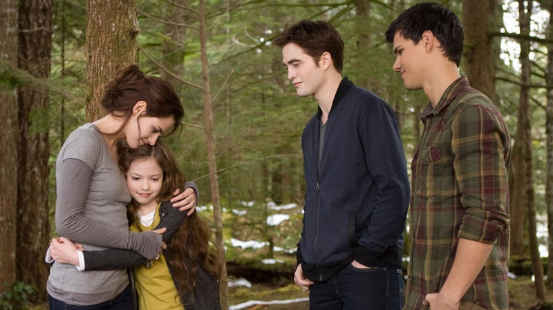 Kristen Stewart , Robert Pattinson, Taylor Lautner, and Mackenzie Foy in a scene from eOne Films Canada's 'Breaking Dawn - Part 2'