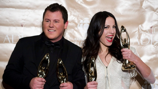 Maxime Landry and Marie-Mai hold up their Felix awards for best male and female performer's of the year at the ADISQ music industry awards show ceremony in Montreal, Sunday, November 7, 2010. THE CANADIAN PRESS/Graham Hughes