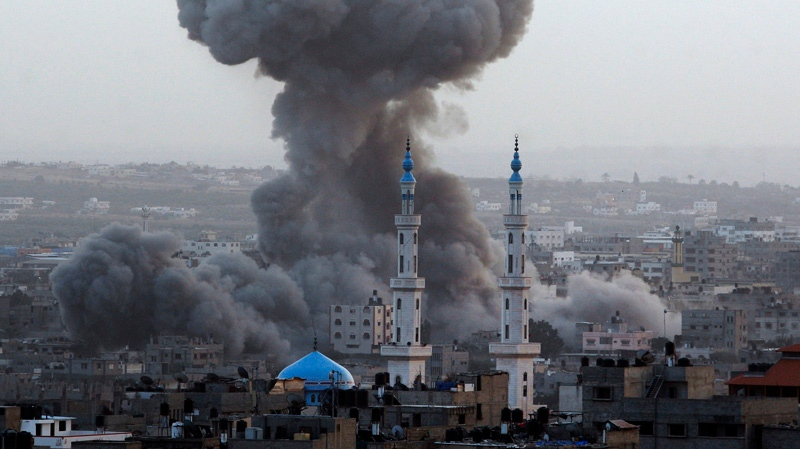 Smoke rises during an explosion from an Israeli forces strike in Gaza City, Saturday, Nov. 17, 2012. Israel bombarded the Hamas-ruled Gaza Strip with nearly 200 airstrikes early Saturday, the military said, widening a blistering assault on Gaza rocket operations by militants to include the prime minister's headquarters, a police compound and a vast network of smuggling tunnels. (AP Photo/Hatem Moussa)