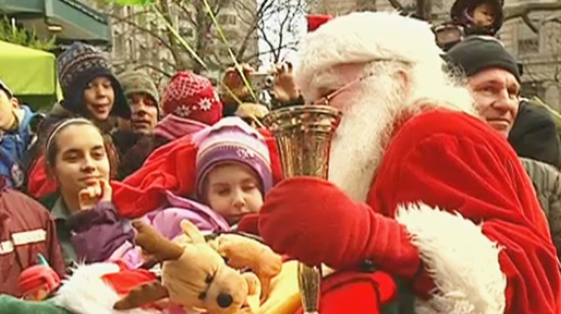 Santa Claus mingled with his starstruck fans in Montreal's annual parade Saturday.