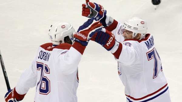 Montreal Canadiens defenseman P.K. Subban, left, is congratulated by Andrei Markov, right, after his goal during the first period of an NHL hockey game in Boston, Thursday, Nov. 11, 2010. (AP Photo/Charles Krupa)