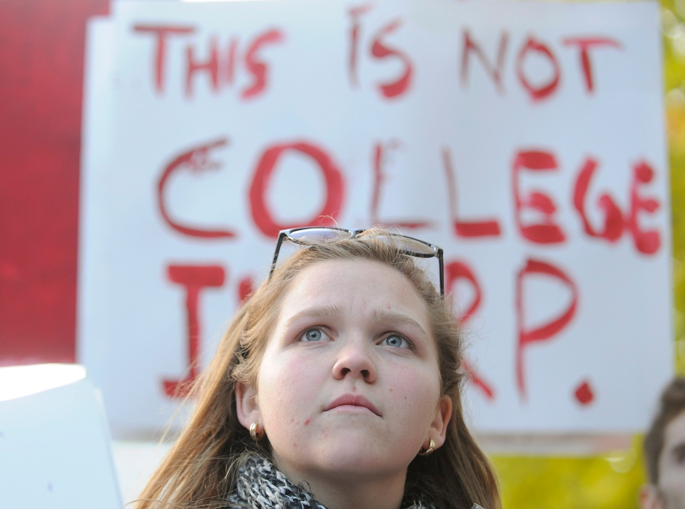 A protester participates in a demonstration in Montreal, Thursday, November 22, 2012, where a large crowd gathered to call on the Quebec government to provide free education. THE CANADIAN PRESS/Graham Hughes.