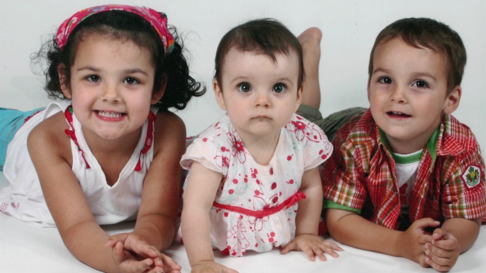 Lorelie, 5, Anaïs, 2, and Loïc Desautels, 4, are shown in a family photo.