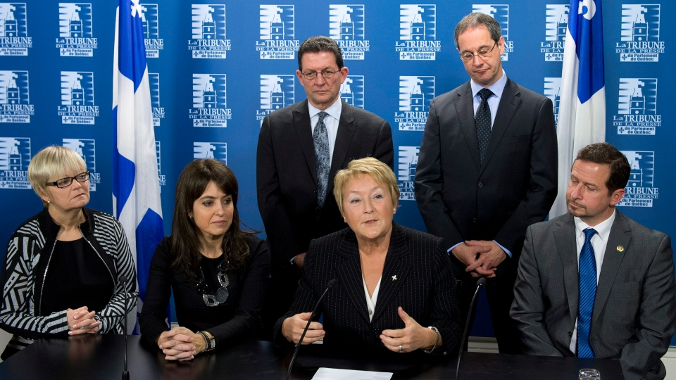 Quebec Premier Pauline Marois, centre right, comments on the cabinet shuffle in Quebec City on Tuesday, Dec. 4, 2012. (Jacques Boissinot / THE CANADIAN PRESS)