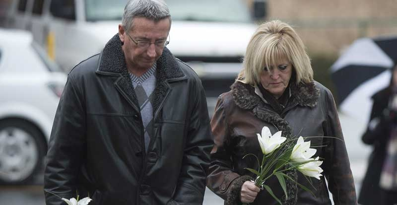 Mourners arrive at a church in Acton Vale, Que., Saturday, December 8, 2012, for funeral of Loreilie (5), Loic (4) and Anais (2). THE CANADIAN PRESS/Graham Hughes