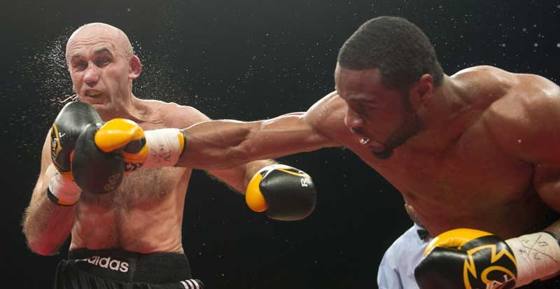 Jean Pascal, from Laval Que., lands a right to the head of Aleksy Kuziemski, from Poland, during their light heavyweight fight Friday, December 14, 2012 in Montreal. Pascal won the bout with a unanimous decision.THE CANADIAN PRESS/Ryan Remiorz