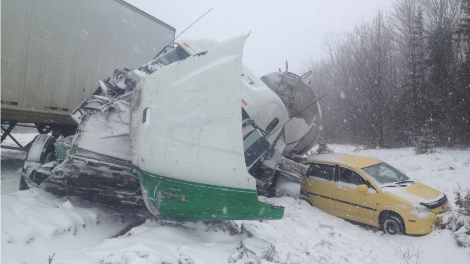 Several 18-wheeler trucks were badly damaged in a chain reaction collision involving dozens of vehicles on Highway 40 near Quebec City (Dec. 17, 2012. CTV Montreal/Fred Bissonnette)
