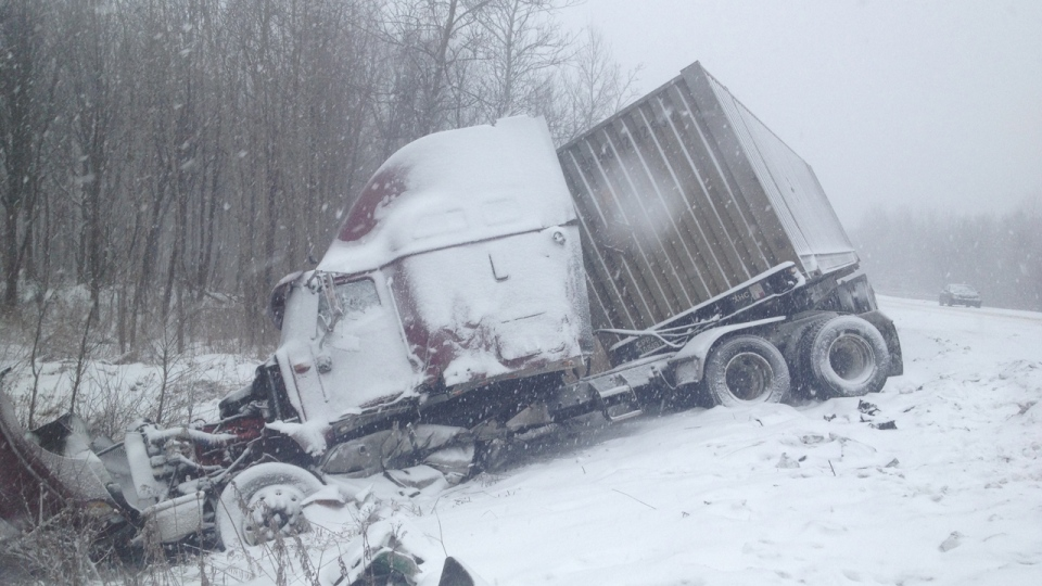 The cabin of a tractor-trailer was crushed when the vehicle was involved in a multiple-vehicle pileup near Quebec City on Dec. 17, 2012. (CTV Montreal/Fred Bissonnette)