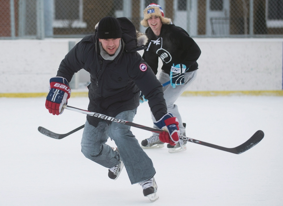 Montreal Canadiens defenceman Josh Gorges chases down a puck during a game of pick-up hockey in Montreal, Wednesday, December 26, 2012. Gorges used Twitter to organize a Boxing Day outdoor hockey game with fans at a neighbourhood rink in Montreal. THE CANADIAN PRESS/Graham Hughes