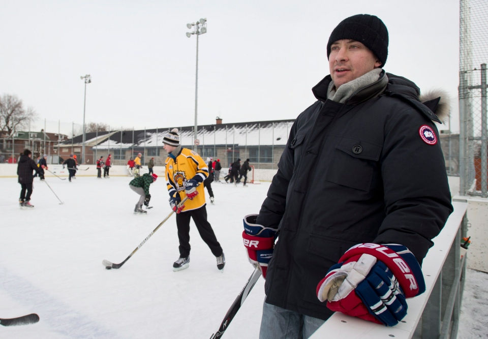 Montreal Canadiens' Josh Gorges keeps an eye on the play during a game of pick-up hockey in Montreal, Wednesday, December 26, 2012. Gorges used Twitter to organize a Boxing Day outdoor hockey game with fans at a neighbourhood rink in Montreal. THE CANADIAN PRESS/Graham Hughes