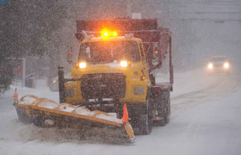 A snow removal truck clears a road near Montreal Thursday, Dec. 27, 2012 during the first major snowstorm of winter in the region. THE CANADIAN PRESS/Graham Hughes.