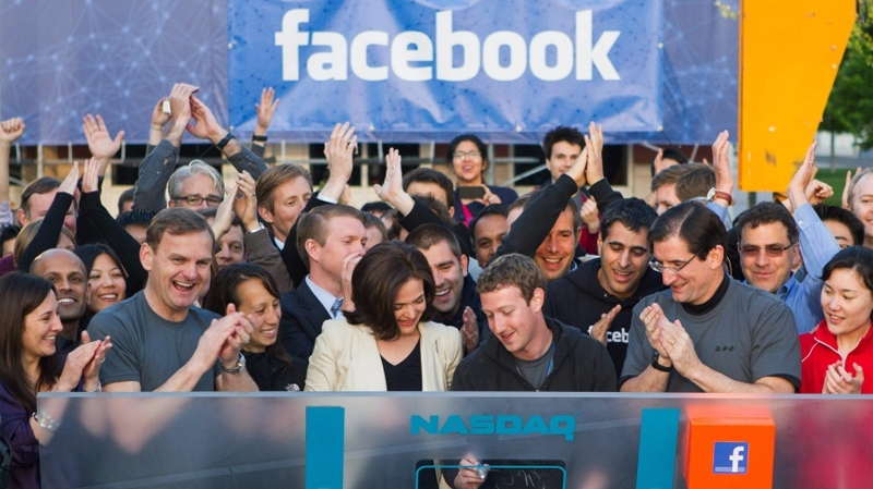 Facebook founder, Chairman and CEO Mark Zuckerberg, centre, rings the opening bell of the Nasdaq stock market, Friday, May 18, 2012, from Facebook headquarters in Menlo Park, Calif. The social media company priced its IPO on Thursday at $38 per share. (AP / Nasdaq via Facebook, Zef Nikolla)