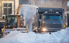 A snow removal crew clears a street in Montreal, F
