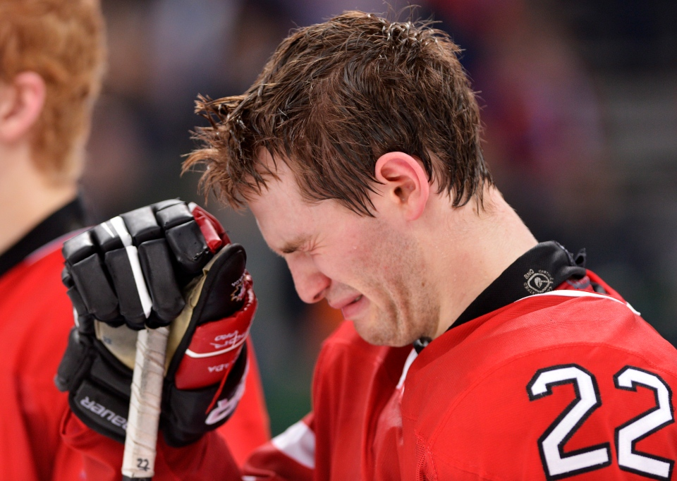Canada forward Boone Jenner cries after losing to Russia during overtime bronze medal hockey action at the IIHF World Junior Championships in Ufa, Russia, on Saturday, Jan. 5, 2013. (Nathan Denette / THE CANADIAN PRESS)