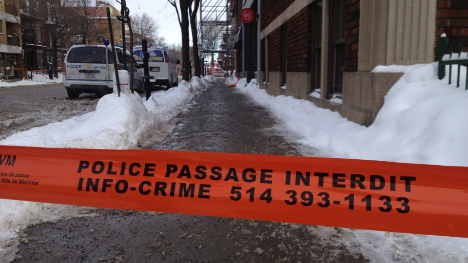 Montreal police set up a perimeter around a plumber's office on Van Horne Ave. after one person was shot on Monday Jan. 7, 2013. (CTV Montreal/Jean-Luc Boulch)
