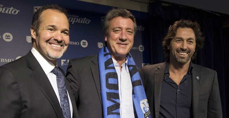 Montreal Impact chairman Joey Saputo, left and Sporting Director Nick Di Santis, right, welcome new head coach Marco Schallibaum at a news conference Tuesday, January 8, 2013 in Montreal.THE CANADIAN PRESS/Ryan Remiorz