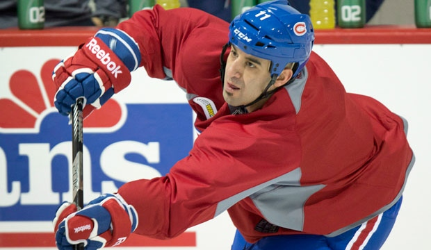 Montreal Canadiens Scott Gomez takes a shot during an informal practice in Brossard, Que., Thursday, January 10, 2013. (Paul Chiasson / THE CANADIAN PRESS)
