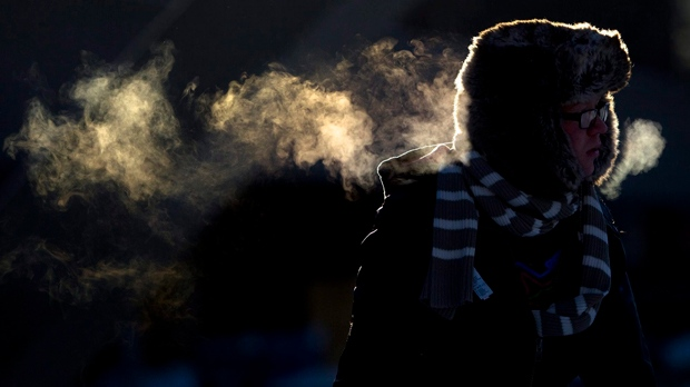 FILE: A man's breath appears while skating on a cold afternoon (The Canadian Press/Darren Calabrese)