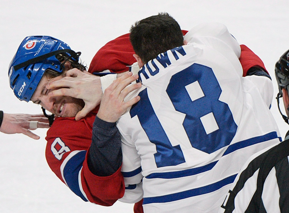 Montreal Canadiens' Brandon Prust (8) fights with Toronto Maple Leafs' Mike Brown during first period NHL hockey action in Montreal, Saturday, January 19, 2013. THE CANADIAN PRESS/Graham Hughes