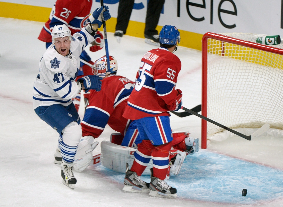 Toronto Maple Leafs' Leo Komarov (47) celebrates a goal by teammate Nazem Kadri (not shown) as Montreal Canadiens' goaltender Carey Price, centre, and Francis Bouillon look on during first period NHL hockey action in Montreal, Saturday, January 19, 2013. THE CANADIAN PRESS/Graham Hughes
