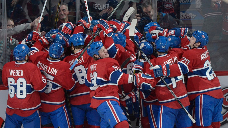 Montreal Canadiens' players celebrate a goal by teammate Andrei Markov against the New Jersey Devils' during overtime NHL hockey action in Montreal, Sunday, January 27, 2013. THE CANADIAN PRESS IMAGES/Graham Hughes