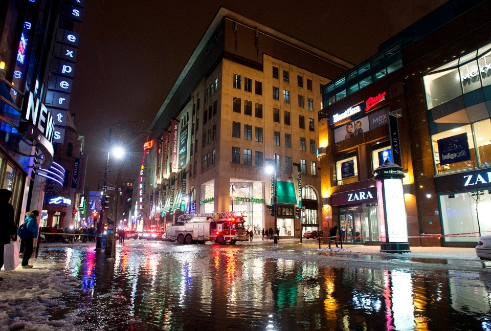 Water floods a street in Montreal, Monday, January 28, 2013, following a water main break.THE CANADIAN PRESS/Graham Hughes