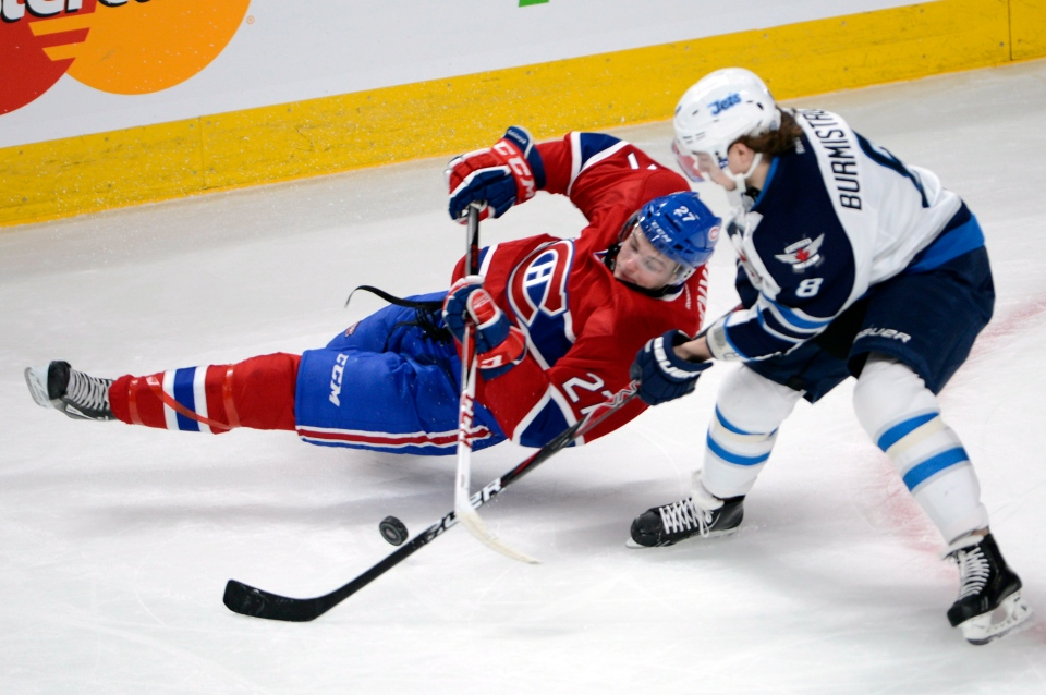 Montreal Canadiens center Alex Galchenyuk (27) battles for the puck with Winnipeg Jets center Alex Burmistrov (8) during first period National Hockey League action Tuesday, January 29, 2013 in Montreal.THE CANADIAN PRESS/Ryan Remiorz