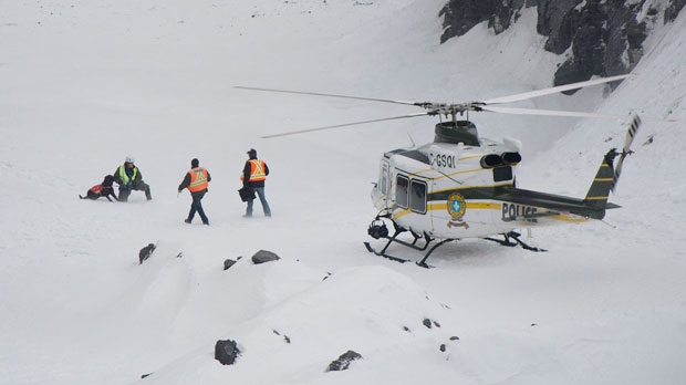 Rescuers prepare to search for workers in a quarry at L'Epiphanie, Que., on Tuesday, Jan. 29, 2013, following a landslide where a number of vehicles fell into the quarry. (The Canadian Press/Graham Hughes)