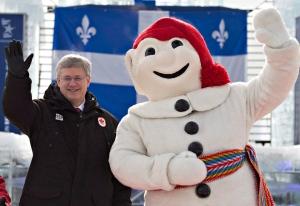 Prime Minister Stephen Harper, flanked by Quebec c