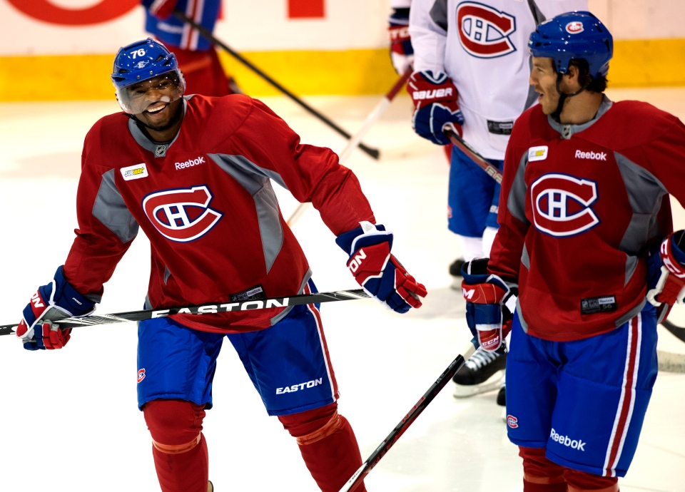 Montreal Canadiens defenceman P.K. Subban, left has a laugh with teammate Brandon Prust as he takes part in his first full practice with the team since signing a two year contract Friday, February 1, 2013 in Brossard, Que.THE CANADIAN PRESS/Ryan Remiorz