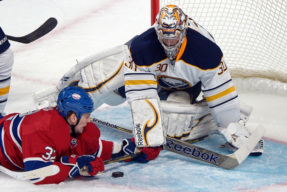 Montreal Canadiens' Travis Moen (32) slides in on Buffalo Sabres' goaltender Ryan Miller during second period NHL hockey action in Montreal, Saturday, February 2, 2013. THE CANADIAN PRESS IMAGES/Graham Hughes.