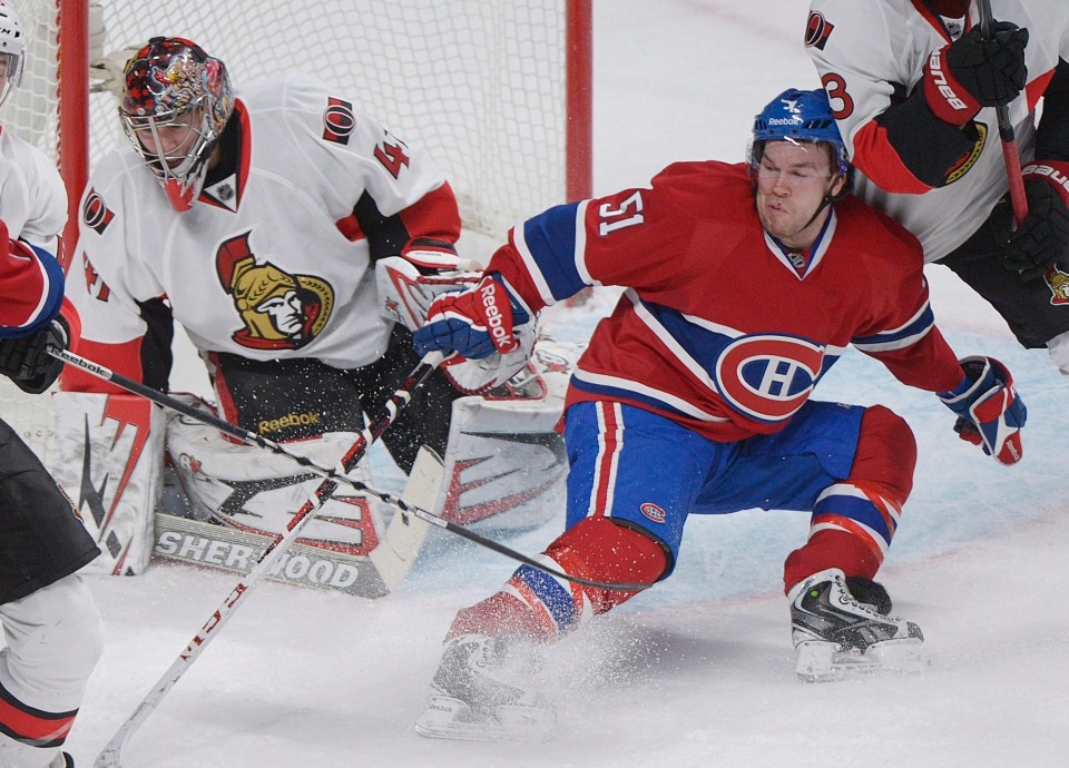 Montreal Canadiens' David Desharnais slides in on Ottawa Senators' goaltender Craig Anderson during first period NHL hockey action in Montreal, Sunday, February 3, 2013. THE CANADIAN PRESS IMAGES/Graham Hughes.