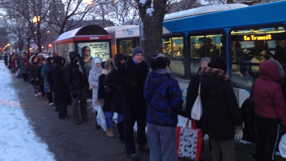 Hundreds of people wait in line for special shuttle buses after service broke down on the Montreal metro's Green line (CTV Montreal/Jean-Luc Boulch)