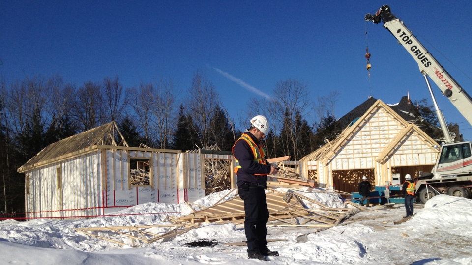 CSST inspectors arrive at the scene of a deadly house collapse in Mirabel on Feb. 5, 2013 (CTV Montreal/Jean-Luc Boulch)