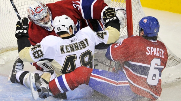 Pittsburgh Penguins' Tyler Kennedy and Montreal Canadiens defenceman Jaroslav Spacek slide into Canadiens goalie Carey Price during third period NHL hockey action Thursday, January 6, 2011 in Montreal. The Canadiens beat the Penguins 2-1 in a shoot-out. THE CANADIAN PRESS/Paul Chiasson