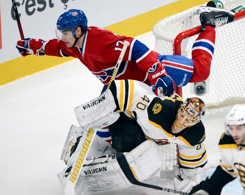 Montreal Canadiens left wing Rene Bourque (17) flies over Boston Bruins goalie Tuukka Rask (40) during first period National Hockey League action Wednesday, February 6, 2013 in Montreal.THE CANADIAN PRESS/Ryan Remiorz