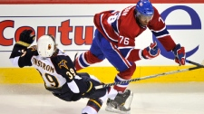 Atlanta Thrashers Tobias Enstrom falls after being checked by Montreal Canadiens defenseman P.K. Subban (76) during first period NHL hockey action Sunday, January 2, 2011 in Montreal. (AP Photo/The Canadian Press, Paul Chiasson)