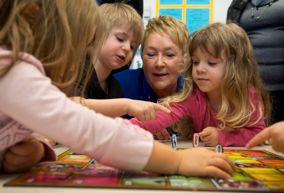Quebec Premier Pauline Marois plays with children at a daycare, Monday, November 12, 2012 in Montreal. Marois announced new places in daycare. THE CANADIAN PRESS/Paul Chiasson