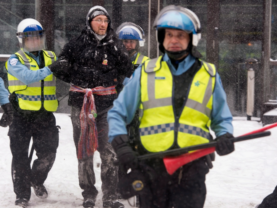 A man is arrested by police during a protest against Quebec's developmental Plan North Friday, February 8, 2013 in Montreal. THE CANADIAN PRESS/Ryan Remiorz