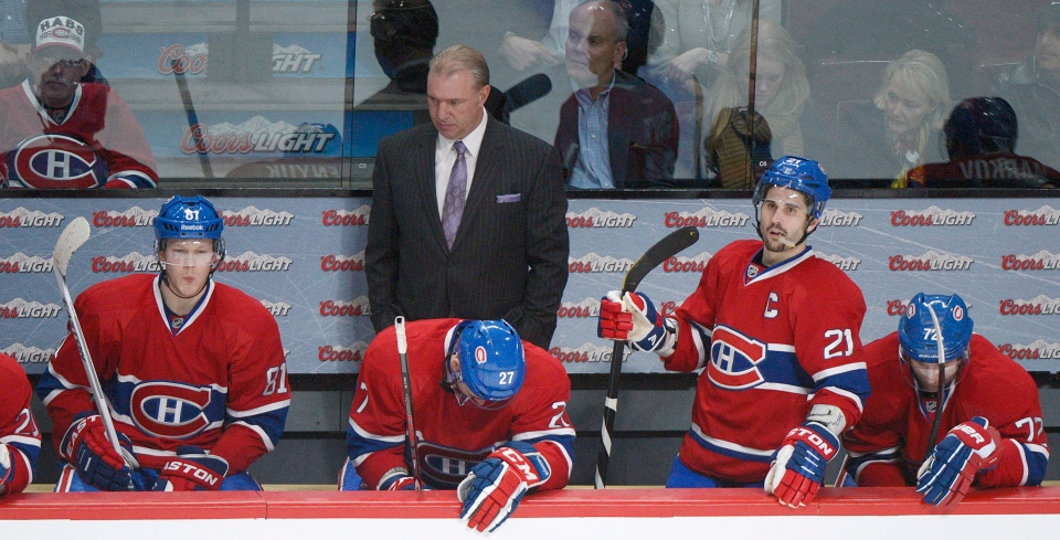 Montreal Canadiens head coach Michel Therrien and players, from left, Lars Eller, Alex Galchenyuk, Brian Gionta and Erik Cole look on from the bench during third period NHL hockey action against the Toronto Maple Leafs in Montreal, Saturday, February 9, 2013. THE CANADIAN PRESS /Graham Hughes.
