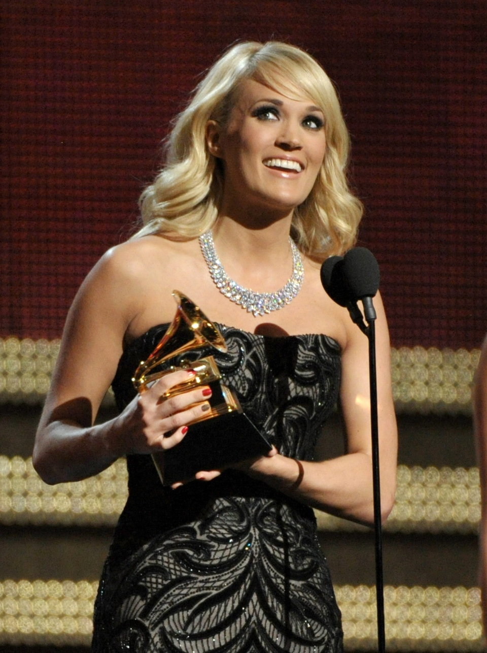 "Carrie Underwood accepts the award for best country solo performance for ""Blown Away"" at the 55th annual Grammy Awards on Sunday, Feb. 10, 2013, in Los Angeles. (AP/ Invision/ John Shearer)"